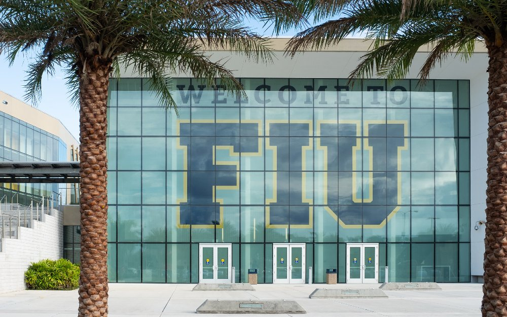 """Welcome to FIU"" on the wall of a building"